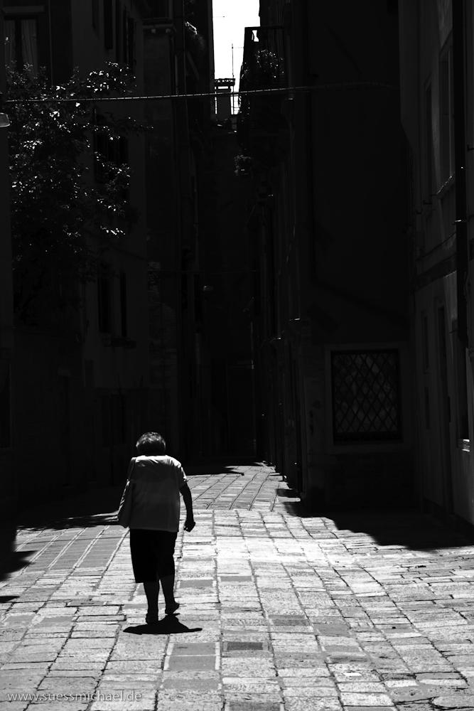 Old Woman in Alleyway